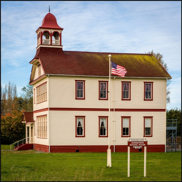 Dungeness-School-House-with-Sign-and-Flag_-_Copy